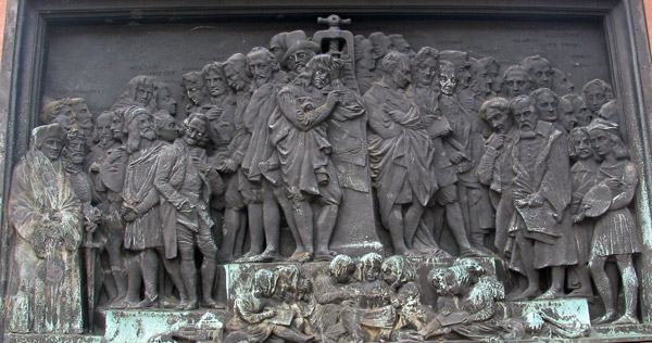 one side of base of gutenberg statue in strasbourg, france