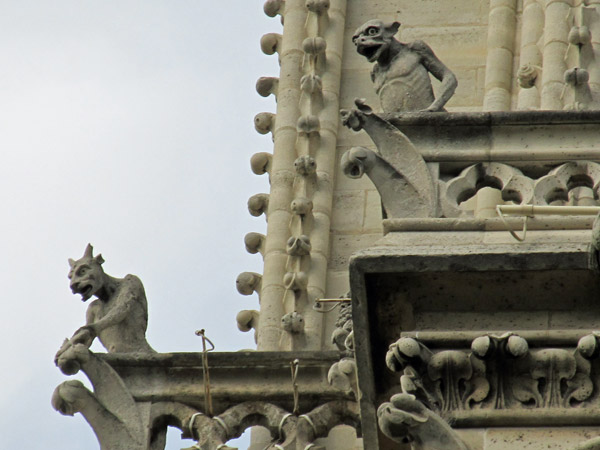 two devils on cathedral notre dame on august 23, 2011