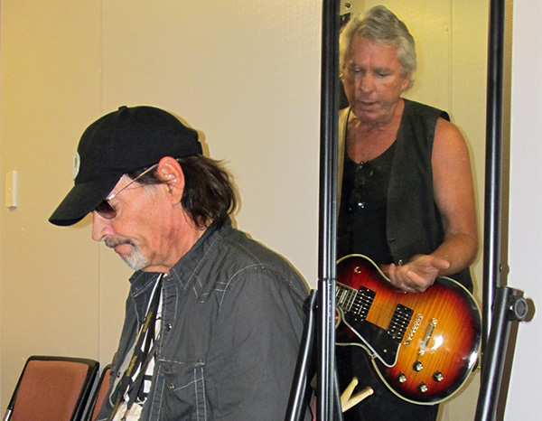 scott asheton (left) + james williamson (in mirror) backstage warming up for the  'big day out' gig in sydney on jan 26, 2011
