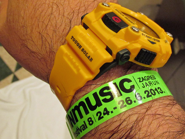 wristband for inmusic festival + watt's limited edition g-shock giallo watch