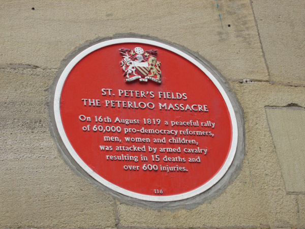 peterloo massacre memorial plaque on the 'free trade hall' in manchester, england on april 13, 2014