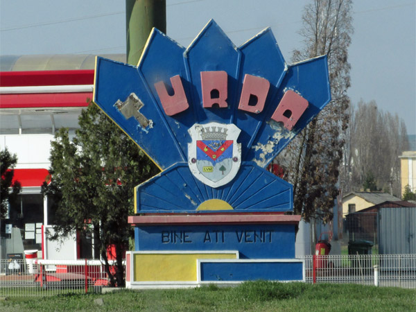 approaching welcome sign for turda, romania on march 29, 2014