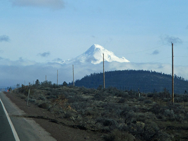 mt hood in the starboard rear mirror while driving in warm springs indian reservation, wora on march 1, 2017