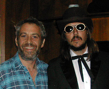 shot of watt and les claypool in 2002